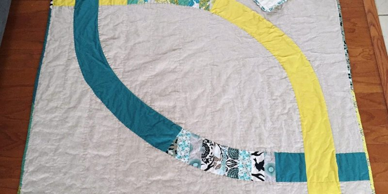 Two Lives Linked: A Modern Wedding Ring Quilt